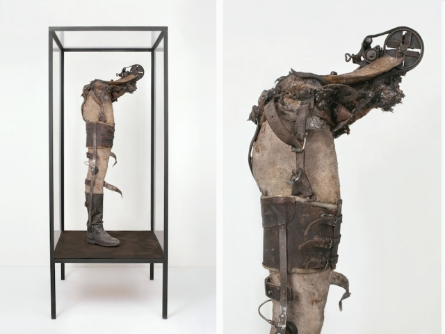 idol-i-jan-manski-2013-86-x-200-x-86-cm-leather-found-army-boot-prosthetic-leg-manequin-parts-bones-found-machinery-polyvinyl-acetate-soi-188313_slide